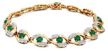 Браслет из комбинированного золота с бриллиантами и изумрудами (023984)